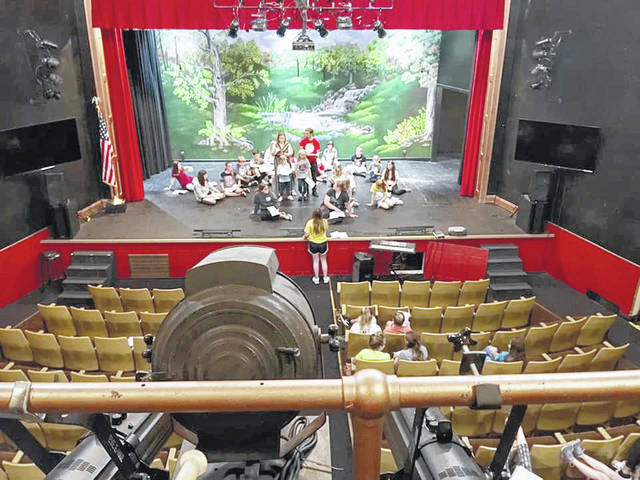 Participants in the Paxton Theatre Foundation's Summer Children's Theatre program are pictured on stage this summer during a rehearsal in the 110-year-old Bainbridge structure.
