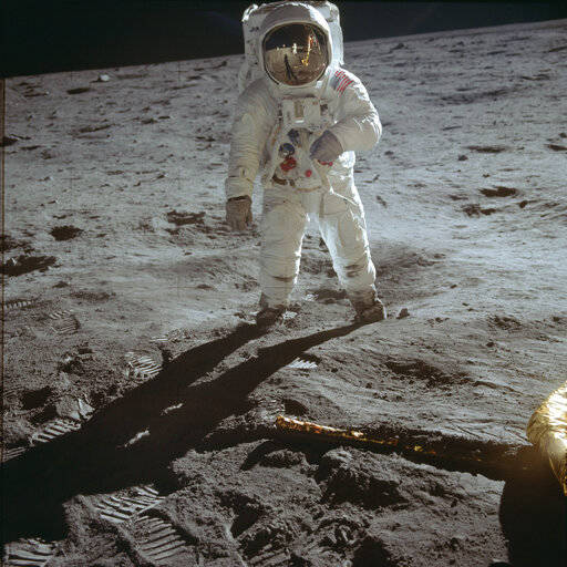 "In this July 20, 1969 photo made available by NASA, astronaut Buzz Aldrin, lunar module pilot, walks on the surface of the moon near the leg of the Lunar Module ""Eagle"" during the Apollo 11 extravehicular activity. (Neil Armstrong/NASA via AP)"