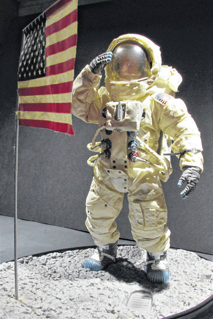 This collector's item of an Apollo astronaut saluting Old Glory on the surface of the moon will be part of the Hillsboro branch library's exhibit commemorating the 50th anniversary of the Apollo 11 moon landing mission.