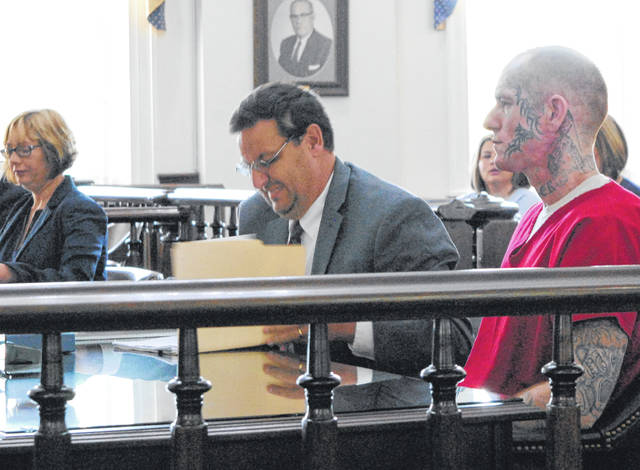 James Carver, right, is pictured Friday in Highland County Common Pleas Court with his attorney, John Cornely. Also pictured to the left is Highland County Prosecutor Anneka Collins.