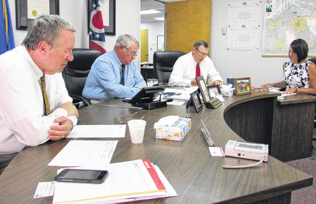 Shown, from left, during Wednesday's meeting of the Highland County Board of Commissioners are Gary Abernathy, Jeff Duncan, Terry Britton and clerk Mary Remsing.