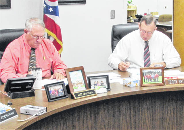 Highland County commissioners Jeff Duncan and Terry Britton are shown at Wednesday's meeting. Fellow commissioner Gary Abernathy was absent due to illness.