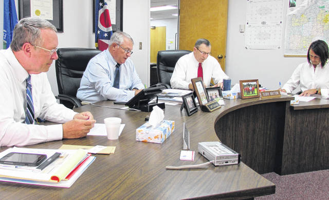 Shown from left, Highland County commissioners Gary Abernathy, Jeff Duncan and Terry Abernathy during Wednesday's scheduled meeting. At right, keeping the minutes, is clerk Mary Remsing.