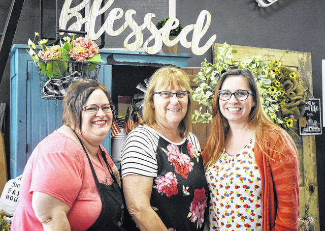 Cundiff's Flowers' staff is pictured, from left, Amy Johnson, owner Karen Cundiff and Crystal Rice welcome customers Monday to its new location.