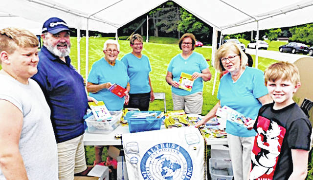 Members of the Hillsboro Elks and Altrusa partnered to deliver books to campers at KAMP Dovetail. The books were purchased with an Elks Gratitude Prant. Pictured with two campers on each end of the photo, from left, are Elk Dan Pearce, and Altrusa members Nancy Graves, Mary Stanforth, Tara Bloom and Jane Tissot.
