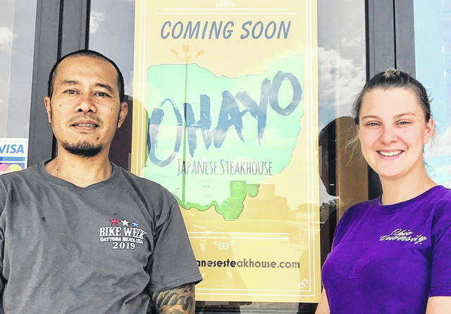 Jaya and Sasha Payadnya are pictured outside the entrance to the Ohayo Japanese Steakhouse they plan to open next month in Hillsboro.