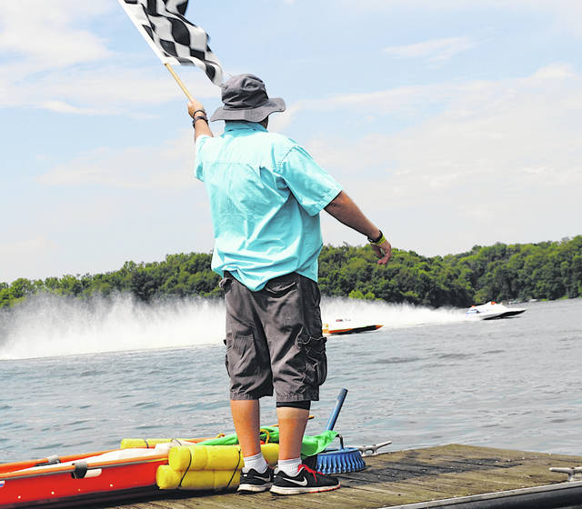 Official Billy Noonan's checkered flag signals the end of a boat race Sunday during Rumble in the Hills at Rocky Fork State Park.