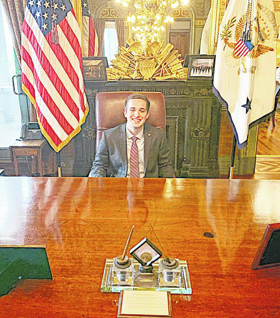 Fairfield High School graduate Ryan Mathews is pictured this week sitting at U.S. Vice President Mike Pence's desk in the White House.