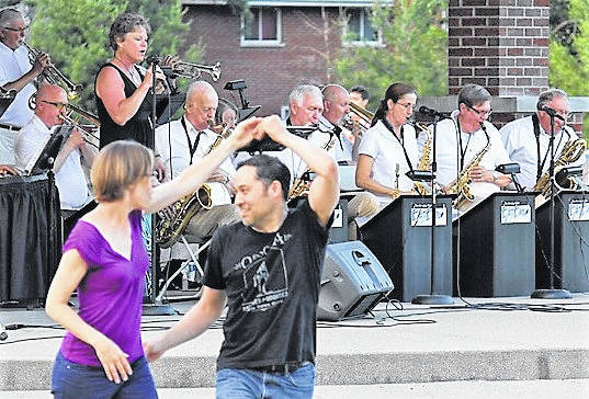 The Monday Night Big Band is shown at a recent outdoor concert with vocalist Julie Stinchcomb and a couple enjoying the unique blend of swing and contemporary music. They'll be performing Saturday, July 13 at The Fling Barn.