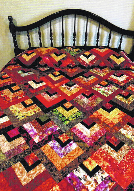 "Quilted by Lori Gossett and called ""Spice Embers,"" this is the quilt that will be raffled off at the Quilts of Highland County Quilt Show July 19-20 at Hillsboro High School."