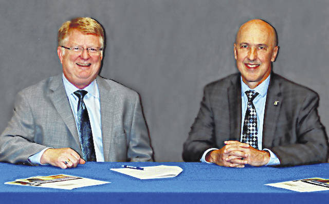 Dr. Kevin Boys, left,, SSCC president, and Dr. Jeffrey Bauer, president of Shawnee State University, sign a partnership agreement to establish the Occupational Therapy Assistant Program Pathway for college students.