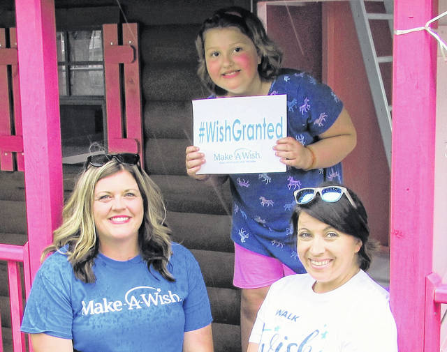 """Shown, from left, at the Monday reveal party of a Lynchburg 8-year-old Olivia Furbee's """"she-shed"""" are Shauna Davidson of Make-A-Wish, Furbee, and Nicole Davis, a Make-A-Wish volunteer."""