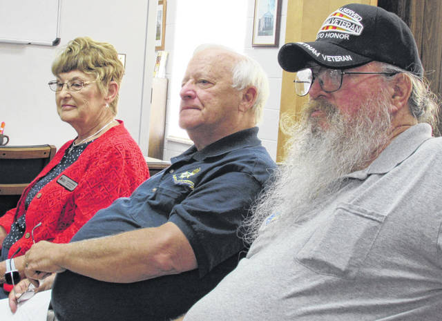 Shown at Wednesday's meeting with Highland County commissioners are, from left, Jane Stowers of the Waw-Wil-A-Way DAR Chapter, Gary Duffield of the Cincinnati SAR Chapter, and Vietnam veteran Gerold Wilkin of the Highland County Veterans Honor Guard.