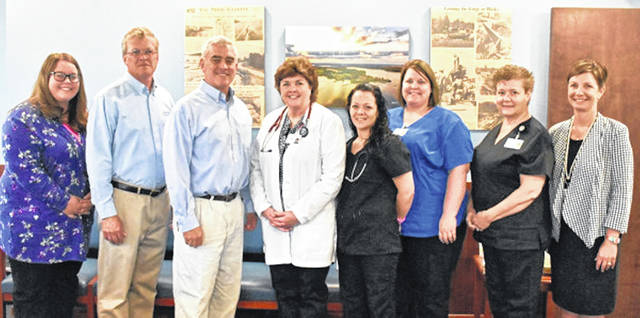 Pictured, from left, are Kelsey Cloud, Highland Health Providers clinic manager; Randal Lennartz, president and CEO of Highland District Hospital; Congressman Brad Wenstrup; Pam Knisley, APRN-CNP at the Rocky Fork Medical Center; Tressa Wedmore, Courtney Dawes and Sonya Scarberry, all Rocky Fork Medical Center staff; and Amanda Warix, Highland Health Providers executive director.