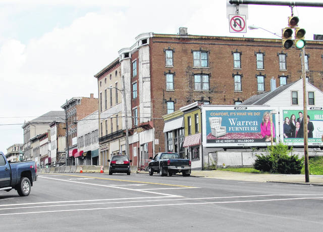 The view Tuesday looking eastbound on W. Main St. in Hillsboro where blockades prevented eastbound traffic. Safety and Service director Dick Donley advised motorists to keep a watchful eye for pedestrians now that the street is open to traffic both ways, and for pedestrians to not use sidewalks that are barricaded.