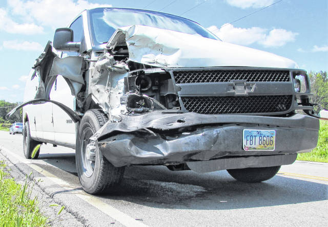 Damage is shown on a Chevrolet van driven by Bradley Brackett of Hillsboro when he took evasive action to avoid a collision Thursday afternoon on SR 124.