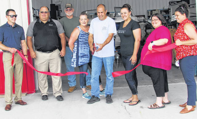 The Highland County Chamber of Commerce took part in multiple ribbon-cutting ceremonies Thursday at three Rocky Fork Lake area businesses, courtesy of the generosity of John Ingersoll, owner of Buckeye Boat Repair & Mobile Service, located between Hillsboro and Marshall. Destiny Bryson, director of the Highland County Chamber of Commerce, said Ingersoll had been a longtime member of the organization and wanted to help the lake region grow. So he sponsored the Chamber memberships of Beechwood Carryout, Bayview Bait & Tackle and Rusty Cabin Restaurant. Shown, from left, at the moment the ribbon was cut at Buckeye Boat Repair are Chamber of Commerce Chair-Elect Seth Phillips of Risk Source, Wayne Bowman of Wilmington Savings Bank, Dwight Tipton, Beth Ingersoll, John Ingersoll, Sarah Roe of Fairway Mortgage Corp., Amanda Hall of People's Bank and Destiny Bryson, Chamber of Commerce director.