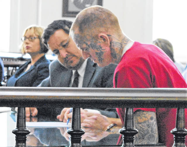 From left to right during the status hearing held on July 26 at Highland County Common Pleas Court are Highland County prosecuting attorney Anneka Collins, defense attorney John Cornely and James Carver, shown here rejecting an offered plea deal. His murder trial is set to start Monday morning.