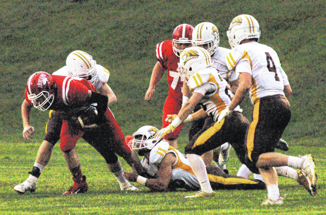 Quarterback Justin Spears fights for five yards in the the Indians' season-opening win Friday in Hillsboro.