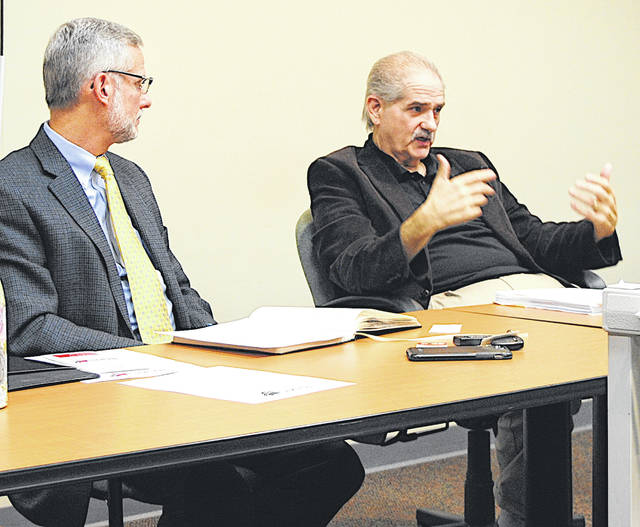 Joe Adray, right, mobility manager with the Highland Area Rural Transportation System, and John Gallagher with Carpenter Marty Transportation, are pictured at a meeting earlier this year.