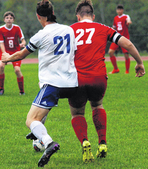 Players from Hillsboro and Chillicothe battle for position during a Tuesday soccer match that was postponed due to the weather. The score was tied 4-4 when the match was called off.
