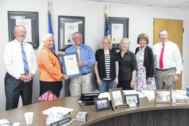 The Hillsboro Towne Club was saluted for its support of civic efforts by the Highland County Board of Commissioners in the form of a proclamation during its Wednesday afternoon meeting. Shown, from left, are commissioner Gary Abernathy; club member Vicky Smith; commissioner Jeff Duncan; club members Siovhan Smith, Patsy Holthouse and Caroline Siemers; and commissioner Terry Britton. The Hillsboro Towne Club was formed in 1938.