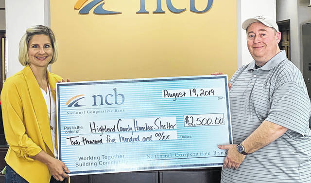 NCB recently donated $2,500 to the Highland County Homeless Shelter for building repairs and maintenance. Pictured are NCB's Mary Alice Hartley, left, and Homeless Shelter Executive Director Greg Hawkins.