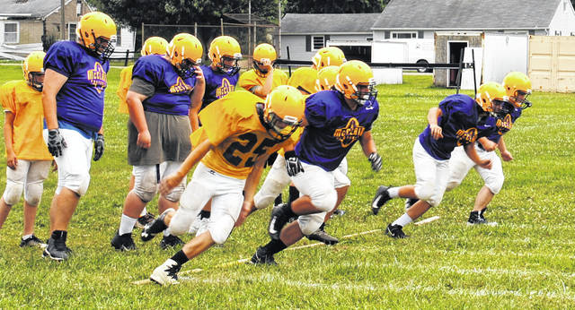 Members of the McClain football are pictured during a preaseason practice this week. The Tigers open the regular season Aug. 30 at home against Adena.