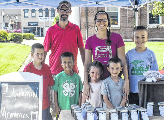 "Kevin and Brooke Krannitc, with their children, Jake, Seth, Sara, Cole and Reed, show off their homemade ""Jammin' Momma"" branded products available for sale at the Hillsboro Farmer's Market."