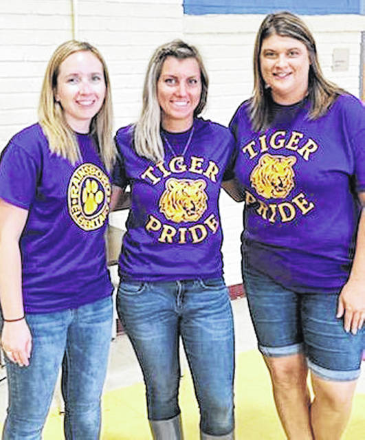 Teachers, from left, Christy Wagner, Jeana McNeal and Vanessa Penwell volunteered during the Lunch Buddies program this summer at the Greenfield schools.