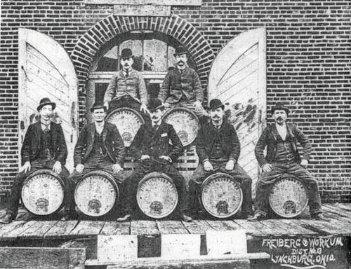Employees sit atop barrels of whiskey at the former Freiburg and Workum Distillery in Lynchburg.