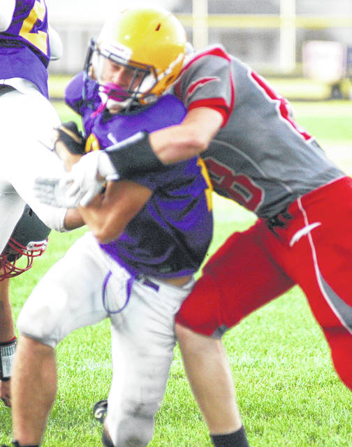McClain quarterbank Garrison Banks scrambling for a play during the Jamboree, McClain Tigers will start their season at home against Adena Warriors Friday Aug. 30 at 7 p.m.
