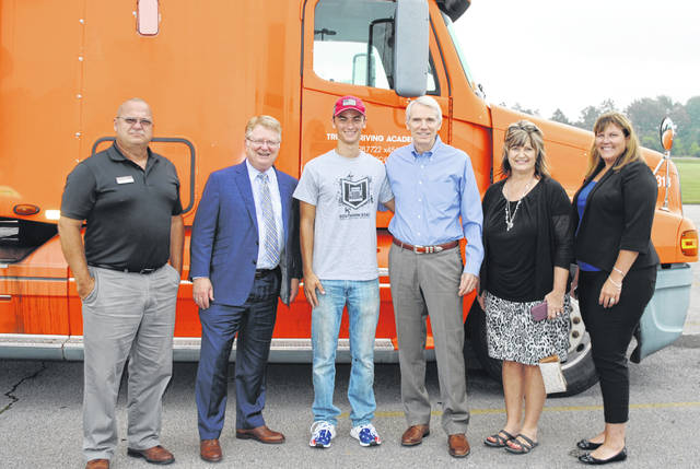 Pictured, from left, are J.T. Smith, Truck Driving Academy director; SSCC President Dr. Kevin Boys; Trevor Brandt, a CDL student at Southern State; Sen. Rob Portman; Karen Preston, Truck Driving Academy office manager; and Amy McClellan, SSCC director of workforce development.