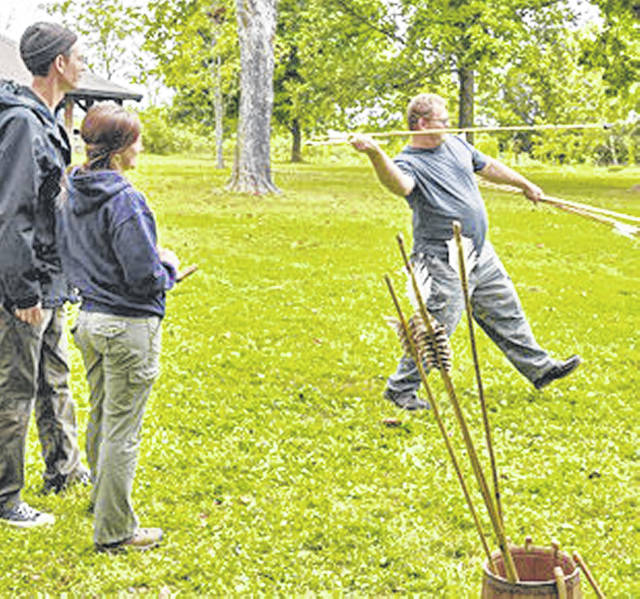 An atlatl demonstration is shown during a previous Archaeology Day at Serpent Mound. This year's event will be held Saturday, Aug. 24.