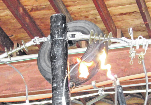 One of South Central Power's live power line safety demonstrations was about objects that aren't perceived as being conductors of electricity. Here, an ordinary tire became a conductor and is seen catching fire after an electrical arc ignited it.