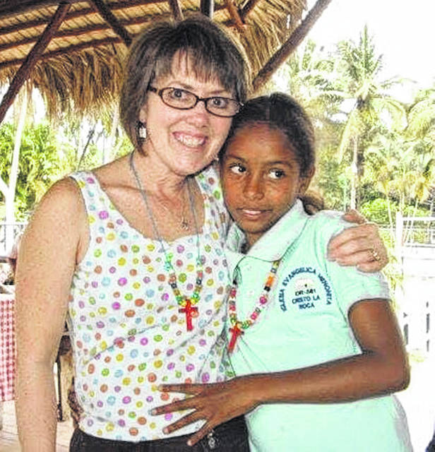 Tonia McLanahan is pictured in the Dominican Republic visiting with a child she sponsored through Compassion International.