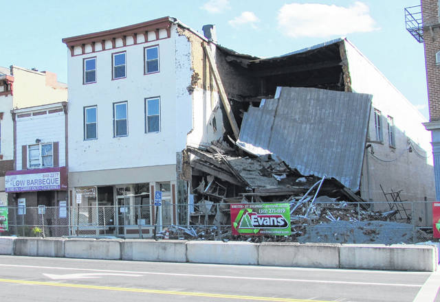 A meeting set for Friday at 2:30 p.m. may decide the fate of these West Main Street buildings, according to Hillsboro Safety and Service Director Dick Donley.