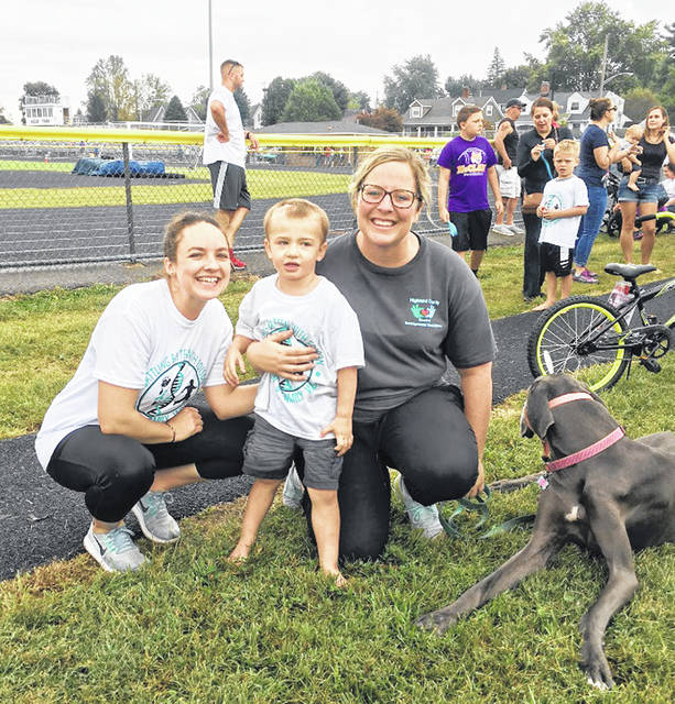 Emily Combs (left), a Hills and Dales preschool teacher and Chelsey Seeling (right) the Hills and Dales preschool coordinator, participated with their student, Edison, in the 5K Battling Batten with Edison on Sept. 21.
