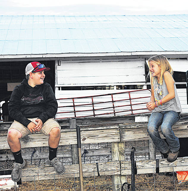 Hillsboro youngsters Connor Yochum, left, and Brianna Foxx share a chuckle Sunday at the 2019 Highland County Fair.
