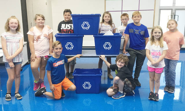 "The students at Bright Elementary have kicked off a recycling program at their school. ""Thanks to the generous donation of recycling tubs from the Highland County Recycling Program and the RPHF Solid Waste District, each classroom has recycling tubs for all classroom recyclable paper,"" said Clinton Davis with Highland County Community Action. Students at Bright will take an active role in the program by collecting paper and assuring that it goes to the large recycling bin. The cafeteria staff will also do their part by eliminating the use of foam bowls in the cafeteria. The school hopes to also schedule presenters to visit classrooms and present educational programs about the importance of recycling in today's world."