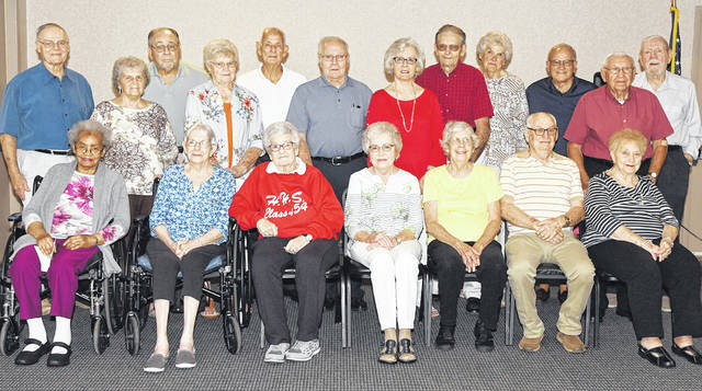 The 65-year reunion for the class of 1954 at Hillsboro High School was held recently at the Ponderosa Banquet Center. There were 21 members of the class present with nine guests. There was good food, and lots of pictures, talk and catching up. Pictured are (seated, from left) Connie (Williams) Hennison, Carol (Travis) Wise, Ellen Duncanson, Carlene (Bonham) Achor, Margie (Gotherman) Green, Henry Rotroff and Georgianna (Ward) Burton; (standing, from left) Larry Hedges, Carol (Marsh) Payne, Howard Wallace, Ruth (Thompson) Bloom, Jim Snyder, Lloyd Satterfield, Eleanor (Kelley) Williams, Richard Williams, Jean (Wharton) McKenzie, Don Shaffer, Fred Burton and Bob Wollard. Not pictured are Marcia (Willson) Bohley and Chuck Brown.