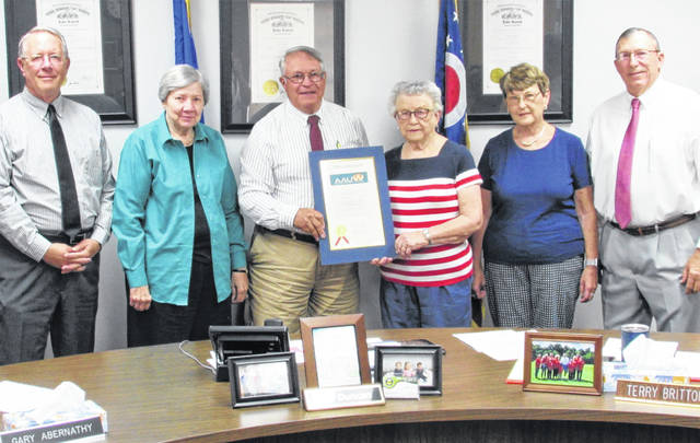 The Highland County Board of Commissioners issued a proclamation Wednesday honoring the American Association of University Women and its local members for their many civic activities since their inception 40 years ago. Shown, from left, are commissioner Gary Abernathy, AAUW member Virginia Purdy, commission president Jeff Duncan, AAUW members Loretta Dean and Jane Stowers, and commissioner Terry Britton.