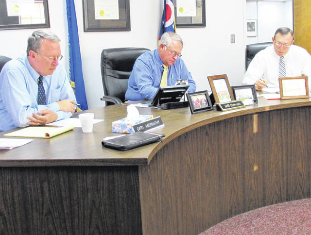 Highland County commissioners, from left, Gary Abernathy, Jeff Duncan and Terry Britton are pictured during Wednesday's meeting.