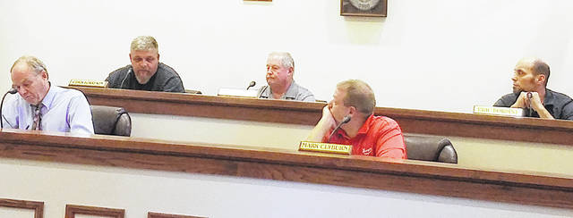 Greenfield Council members (l-r) Phil Clyburn, Chris Borreson, Bob Bergstrom, Mark Clyburn and Eric Borsini are pictured at Tuesday's meeting as Borreson addresses those present.