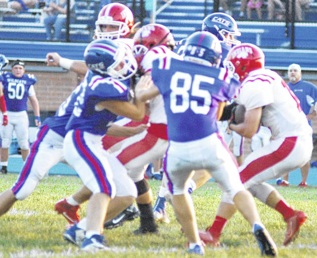 Hillsboro's Keith Doughman fighting for yardage early in the game against the Wildcats