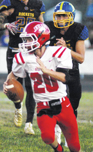 Hillsboro's Justin Spears on the run in photo shown above