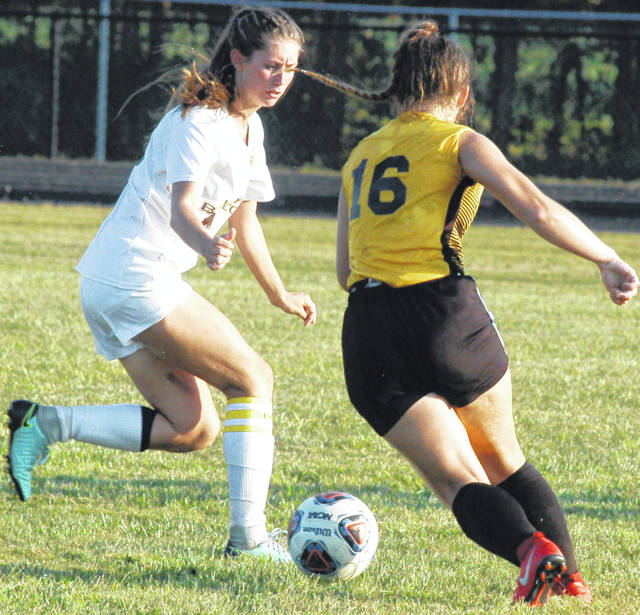 Belle Brinkman going for the goal for the Lady Mustangs shown above