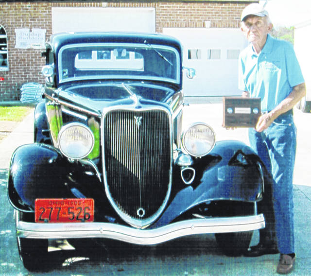 "Bob and Carol Dunlap of Leesburg returned home recently from Auburn, Ind., where they attended the 2019 Central National Early Ford V-8 Club of America Meet. Auburn is the home of the Early Ford V-8 Club Museum. At the meet, out of 161 early Ford V-8 cars that were judged, Bob Dunlap received the President's Choice Award from Michael Driskell (pictured with Dunlap), the organization's national president. Dunlap's car is a 1933 Ford five-window coupe purchased new in Hillsboro by his great-grandfather, Herschel Taylor of Leesburg. The car was given to Bob Dunlap on July 20, 1966 by his grandfather, Jesse Taylor of Washington C.H., and has been in his possession for 53 years. Bob's father, Robert ""Todd"" Dunlap, drove the car to the 1933 World's Far in Chicago. The car has its original top cloth, interior and tools."