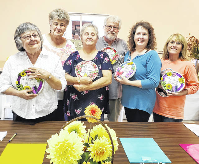 The 2019-20 Hillsboro Garden Club officers are pictured with decorated markers they were awarded.