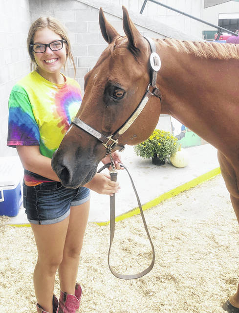 Elena Lowell, a sophomore member of the Hillsboro FFA, is shown with one of her two horses she showed at the 2019 Highland County Fair.